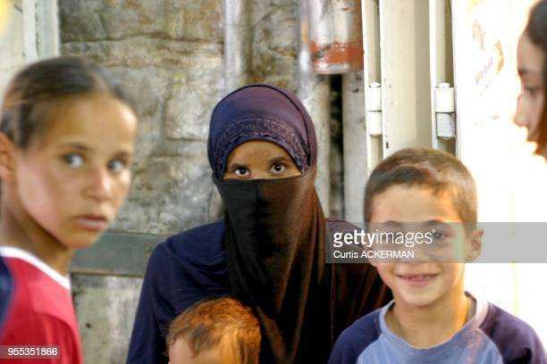 A Muslim woman and with her children in the Muslim Quarter of Jerusalem's Old City The Muslim Quarter derives most of the business from the...