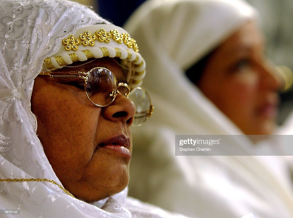 A Muslim woman closes her eyes as she prays during the service at the Masjid Al-Abidin mosque December 6, 2002 in the Queens borough of New York City. Eid al-Fitr is the Muslim holiday after the end of the month-long fast of Ramadan.