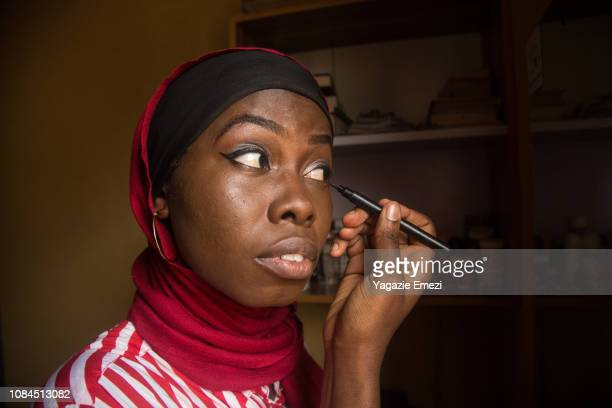 A woman putting on make-up