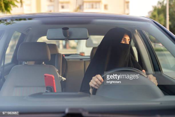 Muslim woman driving a car