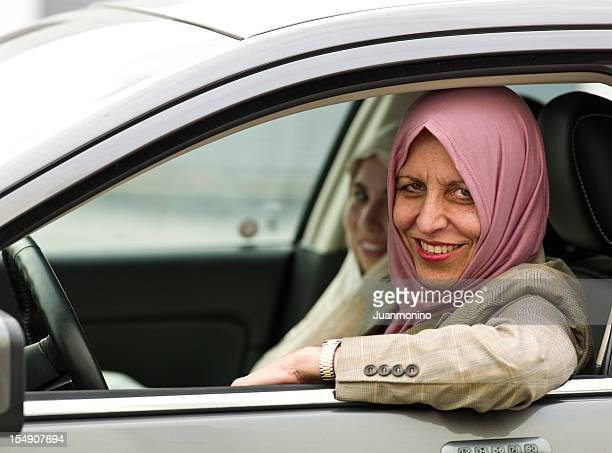 Muslim woman driving her daughter to school