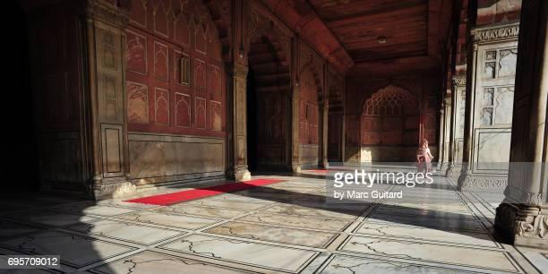 A Muslim woman enters the Jama Masjid Mosque, Delhi, India