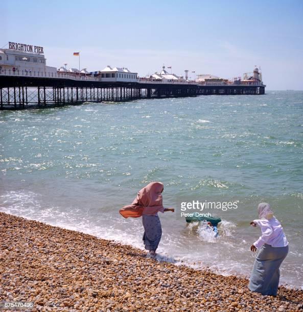 A Muslim woman falls in the sea at Brighton beach on the south coast