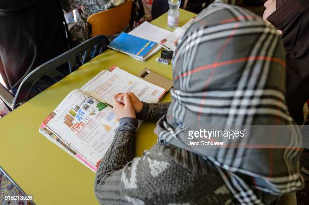 Muslim woman from Syria takes part in a German lesson in the Muslim cultural center and mosque as Aydan Ozoguz German Federal Commissioner for...