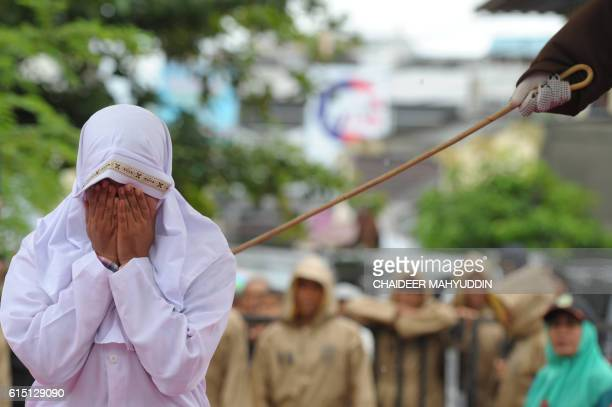 Muslim woman gets caned 23 strokes after being caught in close proximity with her boyfriend in Banda Aceh on October 17 2016 Out of seven couples...