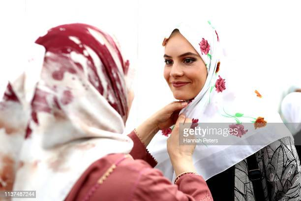 Muslim woman gives away a free hijab to guests attending the Ponsonby Masjid Mosque during an open service to all religions on March 22, 2019 in...