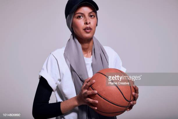 Muslim woman holding basketball