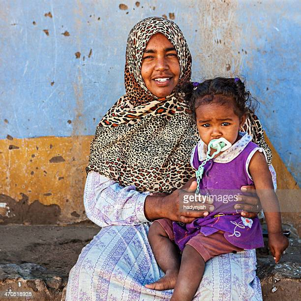 Muslim woman holding her baby, Southern Egypt, Africa
