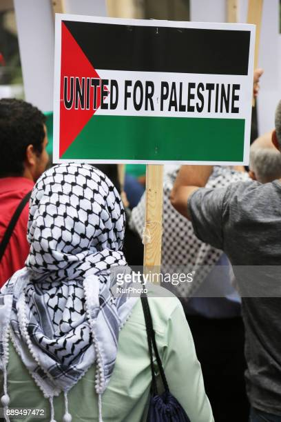 Muslim woman holds a sign saying 'United for Palestine' during a demonstration in Toronto Canada on July 29 to protest against Israel and to show...
