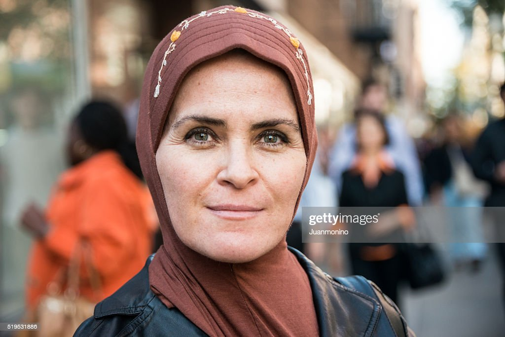 Muslim woman in the city : Stock Photo