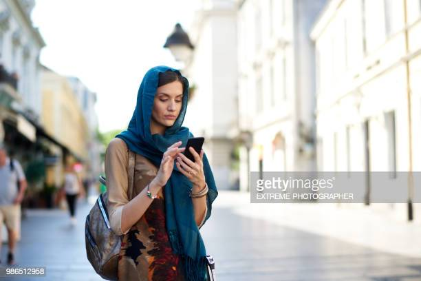 muslim woman in the city - headscarf stock pictures, royalty-free photos & images
