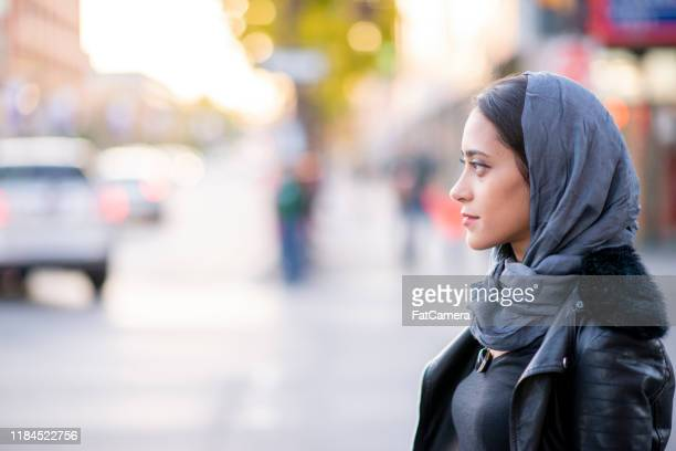 muslim woman in the city stock photo - emigration and immigration stock pictures, royalty-free photos & images