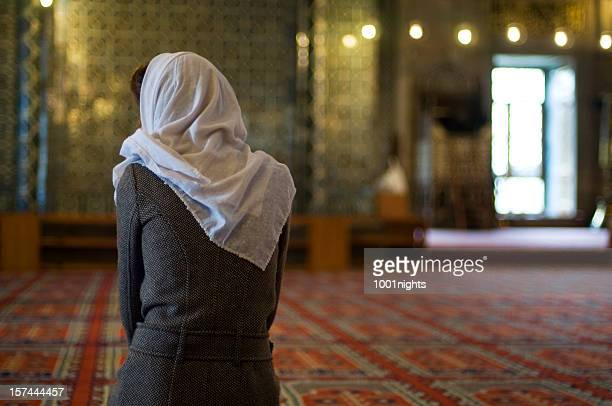 muslim woman is praying in the mosque - mosque stock pictures, royalty-free photos & images
