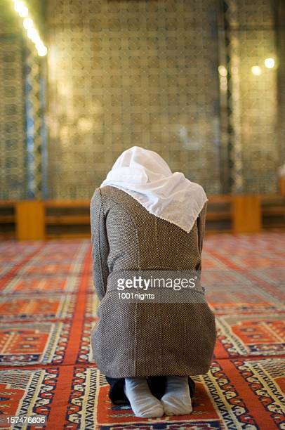 muslim woman is praying in the mosque - salah islamic prayer stock pictures, royalty-free photos & images