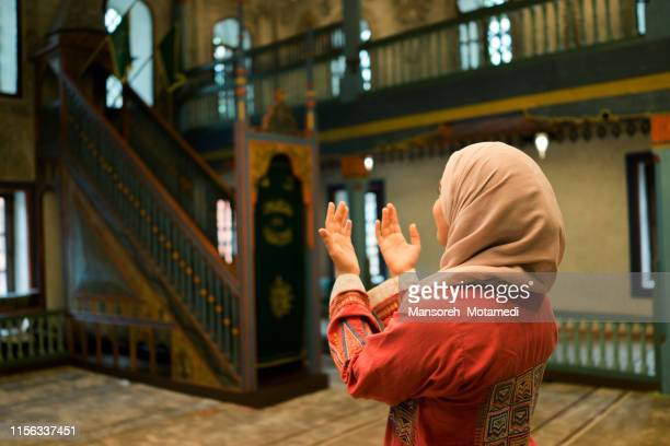 muslim woman is praying - ceremony stock pictures, royalty-free photos & images