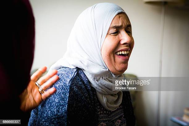 Muslim woman laughing