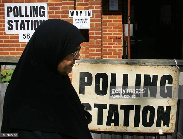Muslim woman leaves a polling station after casting her vote in the general election in Hounslow West London 05 May 2005 Polling stations around the...