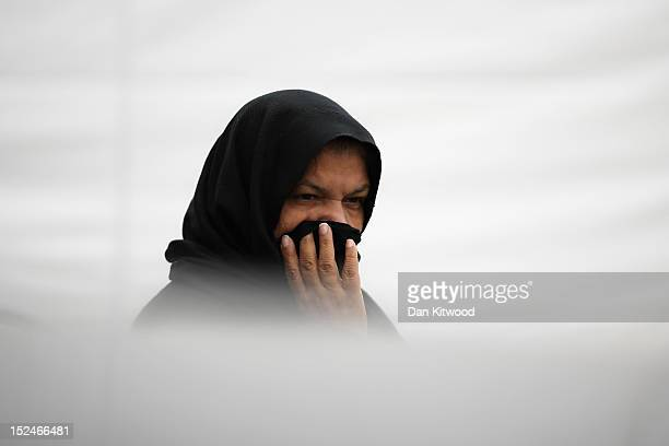 Muslim woman leaves after the departure of the Islamic Khalifa of the Ahmadiyya Muslim community Mirza Masroor Ahmad who spoke at Baitul Futuh Mosque...