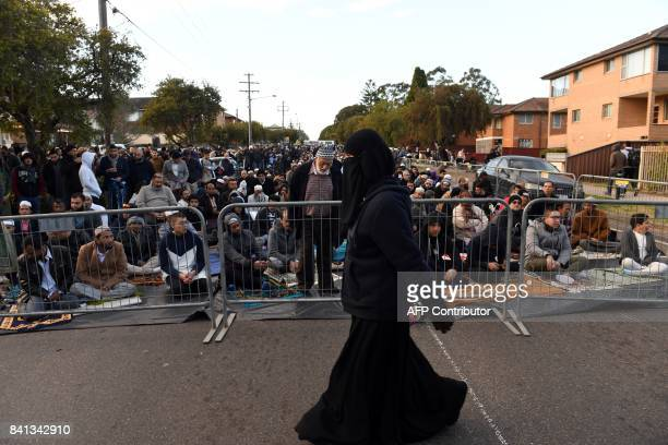 A Muslim woman makes her way to Lakemba mosque for Eid alAdha prayer in Sydney on September 1 2017 Muslims living in Australia celebrate Eid alAdha...