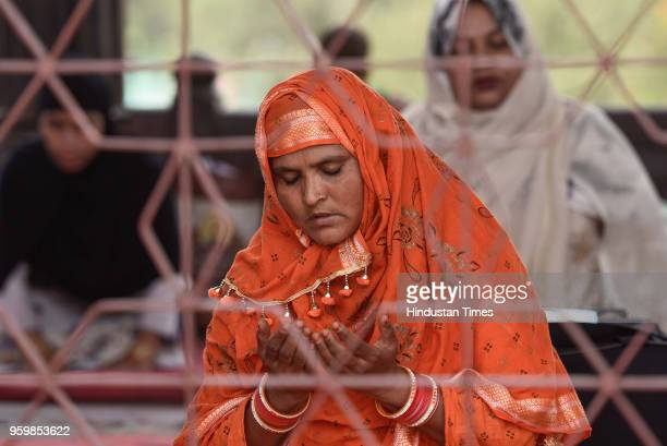 Muslim woman offers prayers on the first Friday of the holy month of Ramadan at the Jama Masjid on May 18 2018 in New Delhi India Muslims all over...