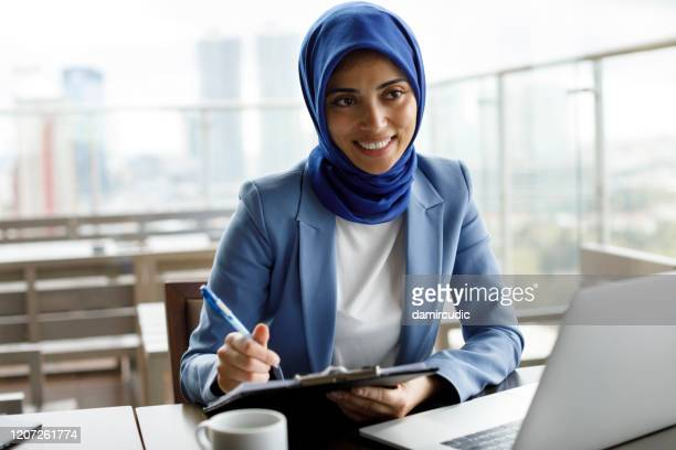 muslim woman on business meeting - bank manager stock pictures, royalty-free photos & images