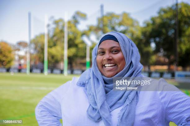muslim woman on  footy oval - afl australian football league stock pictures, royalty-free photos & images