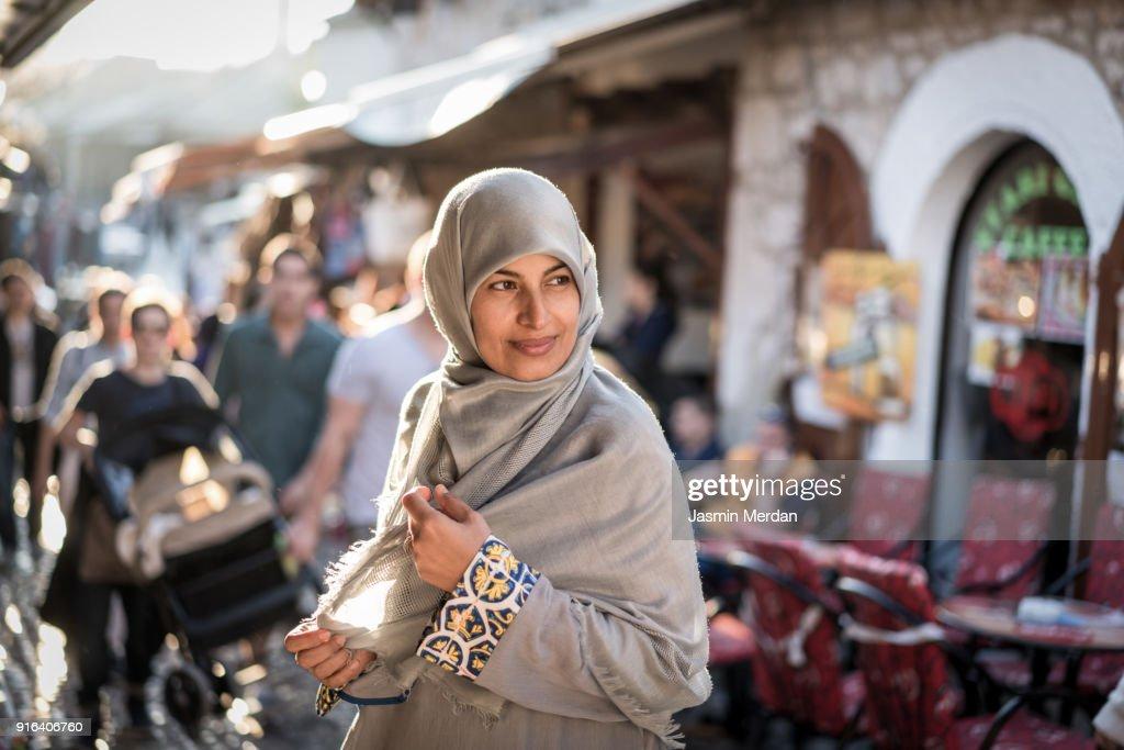 Muslim woman on street : Stock Photo
