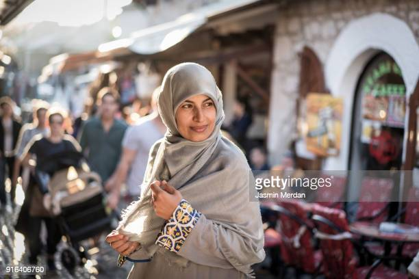muslim woman on street - iranian woman stock photos and pictures
