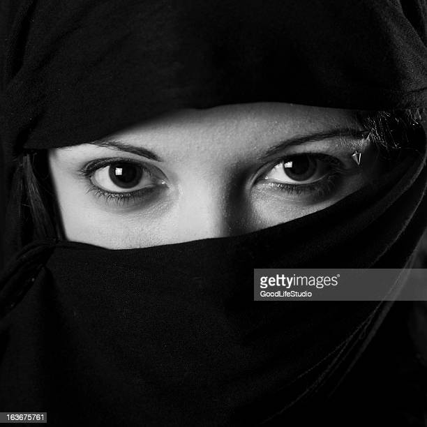 muslim woman - muslim woman darkness stock photos and pictures