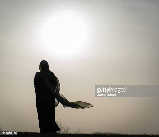 muslim woman - veil stock pictures, royalty-free photos & images