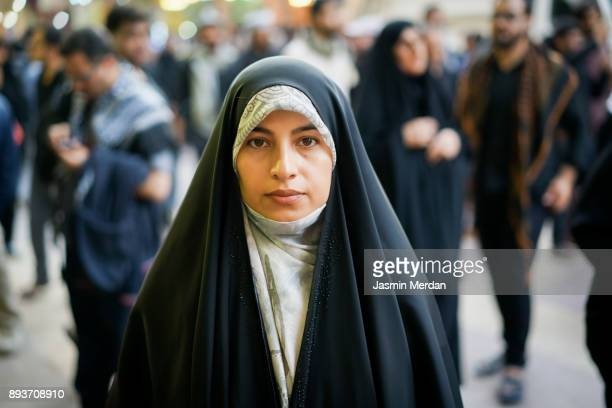 muslim woman portrait on street - iraqi woman stock photos and pictures
