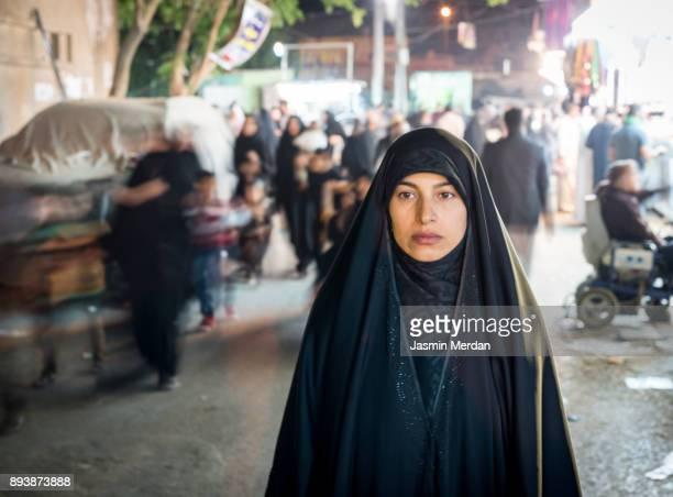 muslim woman portrait on street - シーア派 ストックフォトと画像