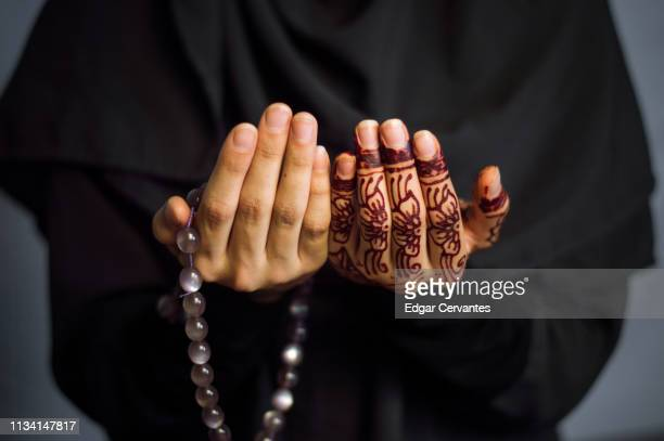 muslim woman praying - religion stock pictures, royalty-free photos & images