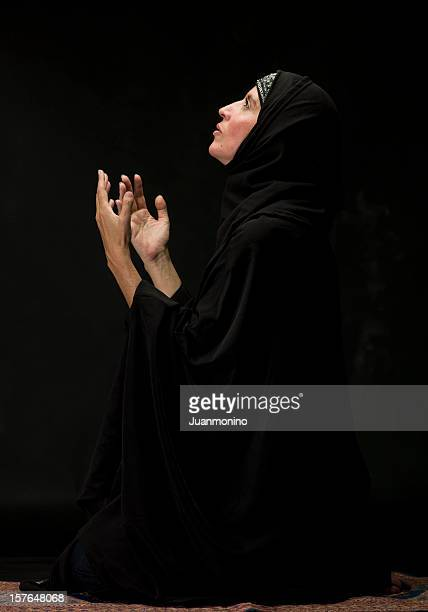 muslim woman praying - north african ethnicity stock pictures, royalty-free photos & images