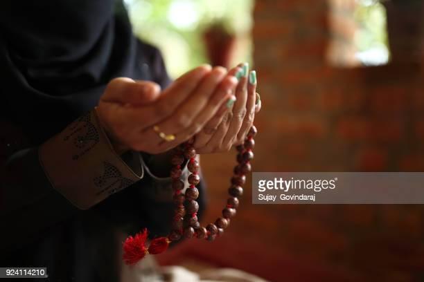muslim woman praying - muslim prayer stock pictures, royalty-free photos & images