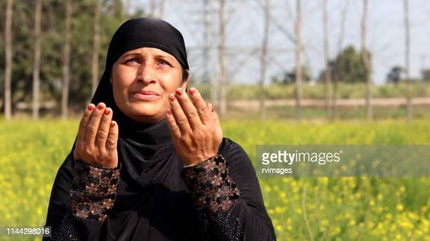 muslim woman praying to god, namaj time - namaz stock pictures, royalty-free photos & images