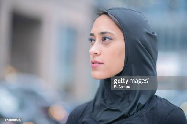 muslim woman prepares to go on a run - identity politics stock pictures, royalty-free photos & images