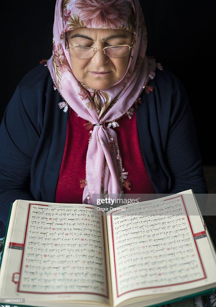 Muslim Woman Reading Quran : Stock Photo