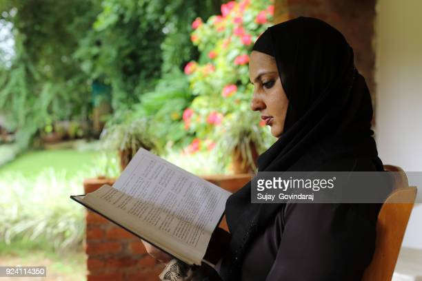 Muslim Woman Reading Religious Book