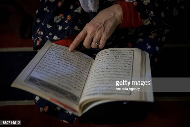 Muslim woman reads Quran at Kocatepe Mosque during the Lailat al Regaip the holy night which marks the start of the holy months of Rajab Shaban and...