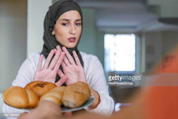 muslim woman refusing an unhealthy food - refusing stock pictures, royalty-free photos & images