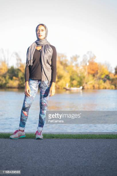 muslim woman running - women's issues stock pictures, royalty-free photos & images
