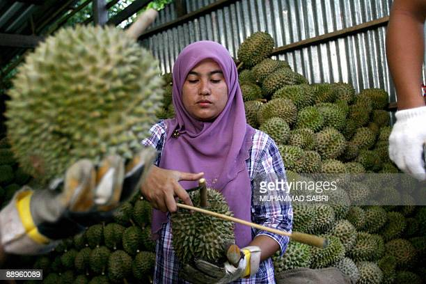 A Muslim woman sells durian fruits at a market in Yala province on July 9 2009 Confidence among Thai consumers rose for the first time since February...