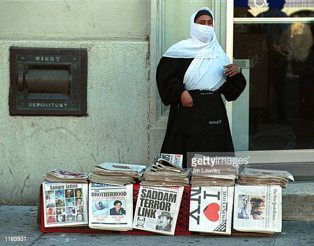 Muslim woman sells New York newspapers September 19, 2001 on Canal Street in New York City eight days after a terrorist attack destroyed the World...