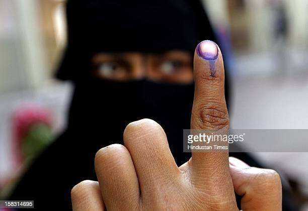 A muslim woman showing the polling mark on her finger during the first phase polling of Gujarat assembly election at Dholka on December 13 2012 in...