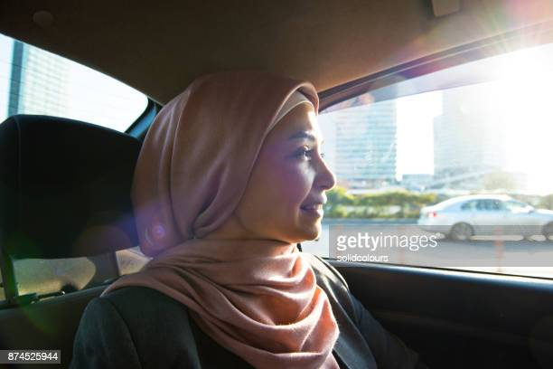 muslim woman sitting in car - turkey middle east stock photos and pictures