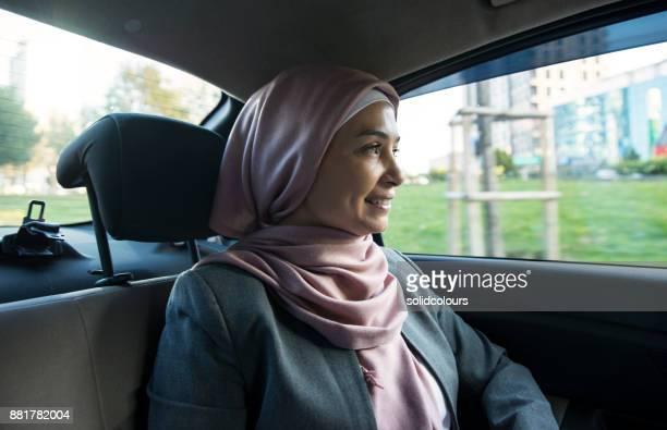 Muslim Woman Sitting In Car