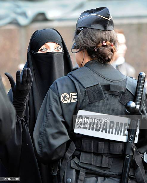Muslim woman speaks with a French gendarme during an identity control, on September 22, 2012 near the prefecture of Lille, northern France, as police...
