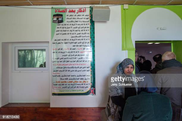 Muslim woman stand in a prayer room in the Muslim cultural center and mosque as Aydan Ozoguz German Federal Commissioner for Immigration Refugees and...