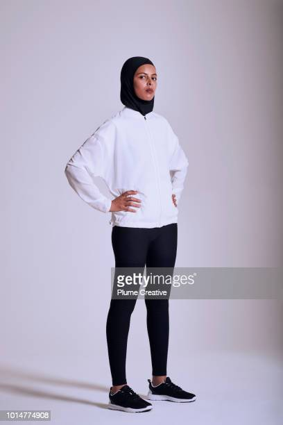Muslim woman striking a power pose and looking to camera with confidence